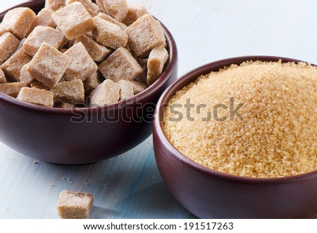 Brown Sugar on a wooden table. Selective focus - stock photo