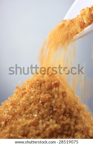 Brown sugar & spoon, close-up shot, shallow DOF - stock photo