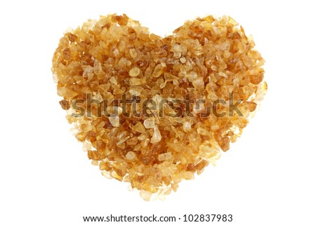 Brown sugar with a shape of heart, isolated on a white background - stock photo