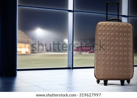 brown suitcase  - stock photo
