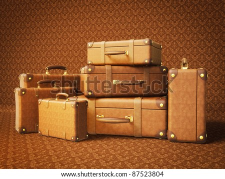 brown suitcase isolated on a brown  background - stock photo