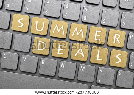 Brown summer deals key on keyboard - stock photo