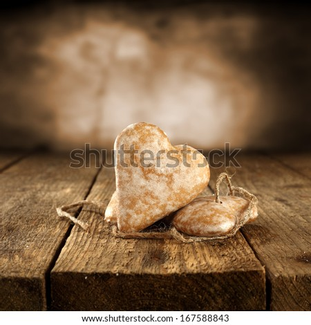 brown table with two sweet hearts  - stock photo