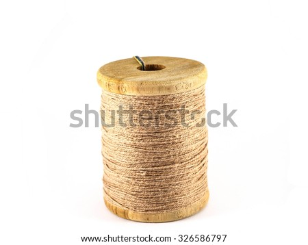 brown thread spool isolated on white background - stock photo