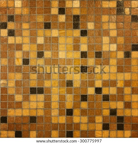 Brown tiled mosaic wall background - stock photo