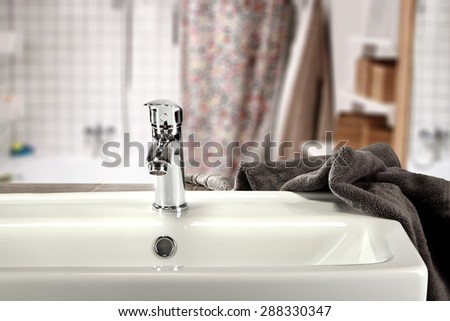 brown towel and sink  - stock photo