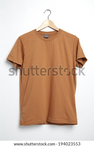 Brown tshirt template on hanger ready for your own graphics. - stock photo
