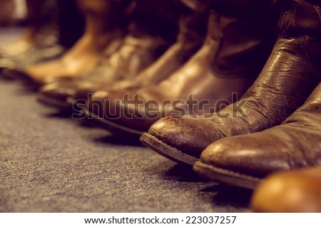 brown vintage leather boots aligned selective focus - stock photo