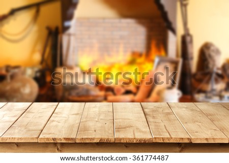 brown wall red fire and fireplace with yellow wooden deck  - stock photo