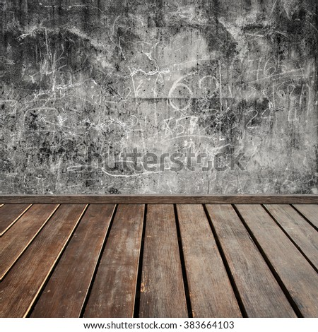 brown wood plank floor with black grunge stone wall background - stock photo