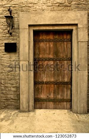Brown wooden door, part of the building - stock photo