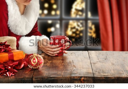 brown wooden table and red mug  - stock photo