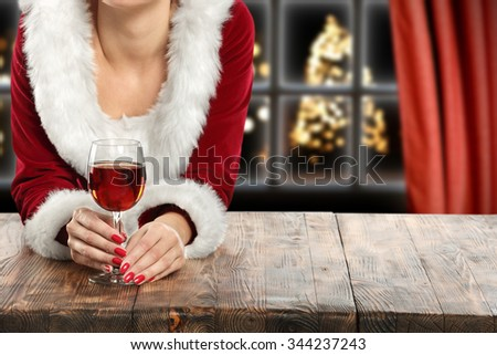 brown wooden table and red wine  - stock photo