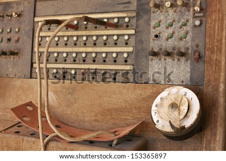 Brown wooden telephone central PBX - stock photo