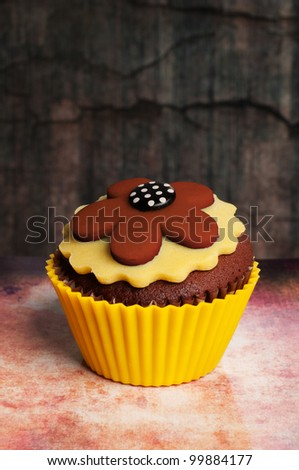 brown yellow chocolate cupcake - stock photo