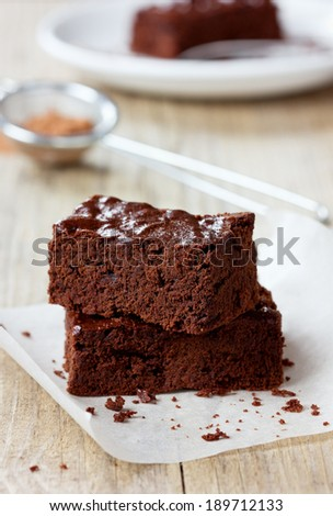 Brownie, closeup chocolate cake on a rustic wooden table, selective focus - stock photo