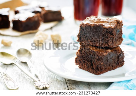 brownie on a white wood background. tinting. selective focus on the top of top brownie - stock photo