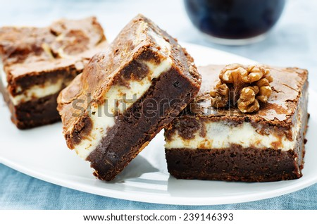 brownie with cream cheese on a light blue background. tinting. selective focus - stock photo