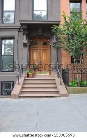 Brownstone Home Entrance with potted flowers  - stock photo