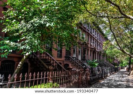 Brownstone Homes along residential Neighborhood sidewalk in Brooklyn, New York - stock photo