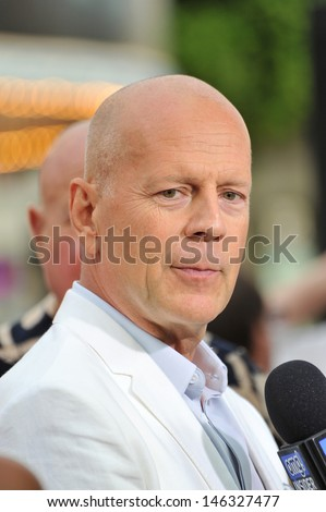 """Bruce Willis at the Los Angeles premiere of his new movie """"Red 2"""" at the Westwood Village Theatre. July 11, 2013  Los Angeles, CA - stock photo"""