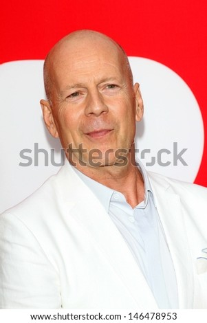 """Bruce Willis at the premiere of Summit Entertainment's """"RED 2,"""" Village Theater, Westwood, CA 07-11-13 - stock photo"""