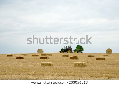 BRUCHHAUSEN, GERMANY 4TH JULY 2014 - Deere & Company, as brand name John Deere, is an American corporation based in Illinois and one of the largest manufacturers of agricultural machinery in the world - stock photo