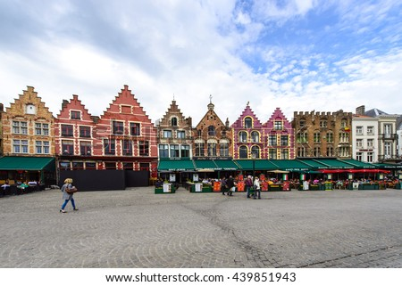 BRUGES, BELGIUM - APRIL 11: Medieval style shops and restaurants around the market place (Grote Markt) on April 11, 2016 in Bruges, Belgium. - stock photo