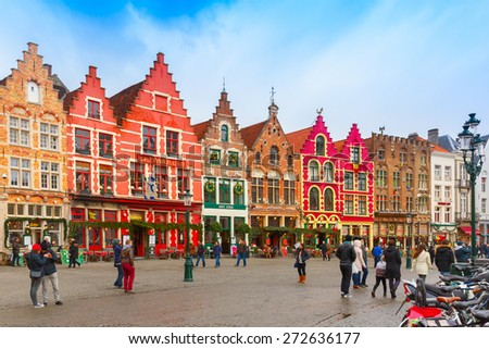 Bruges, Belgium - December 26, 2014: Christmas Grote Markt square of Brugge at morning. Bruges - one of the most beautiful and wonderfully preserved medieval cities in Europe, there is now an - stock photo