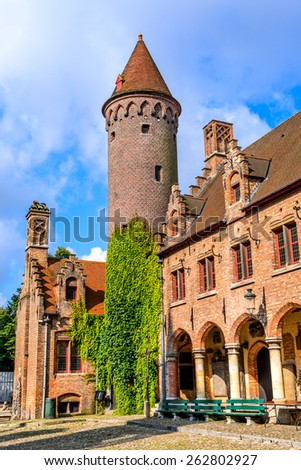 Bruges, Belgium. Medieval brickwork building in downtown historic center of Brugge, gothic city in West Flanders. - stock photo