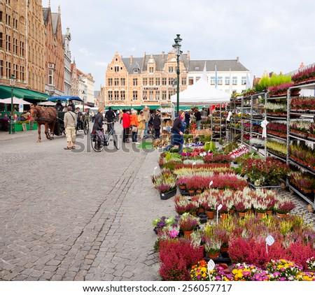 BRUGES, BELGIUM - OCTIBER 15: Center Market of Bruges, Belgium on October 15, 2014. - stock photo