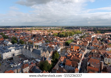 BRUGES, BELGIUM - SEPT 14: The top view of the Town hall, Bruges on September 14 in Bruges (Brugge), Belgium.  The historic city centre is a prominent World Heritage Site of UNESCO. - stock photo