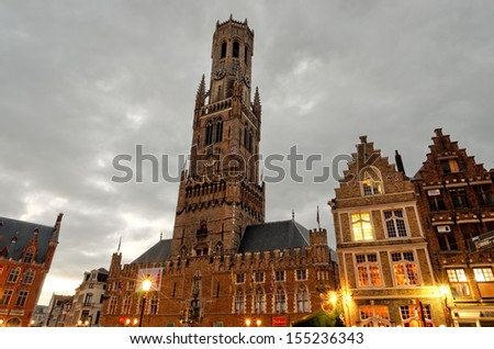 BRUGES, BELGIUM - SEPTEMBER 15: Medieval clock tower on Sep 15 2012 in Bruges, Belgium .The belfry of Bruges, or Belfort, is a medieval bell tower in the historical center of Bruges - stock photo