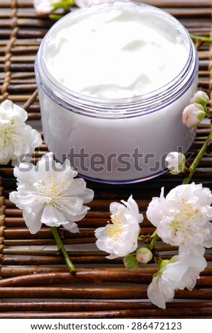 brunch cherry blossoms with cream on mat - stock photo