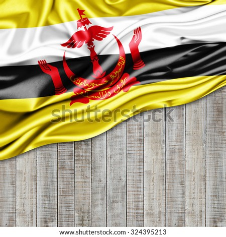 Brunei  flag of silk with copyspace for your text or images and wood background - stock photo