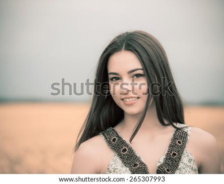 brunette beautiful girl outdoor - stock photo