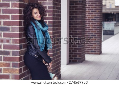 Brunette beautiful stylish caucasian woman in casual outfit on a walk on european city street. copy space - stock photo