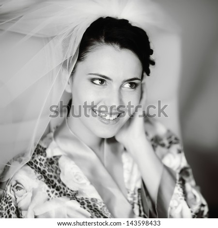 brunette bride is getting ready in the morning - stock photo