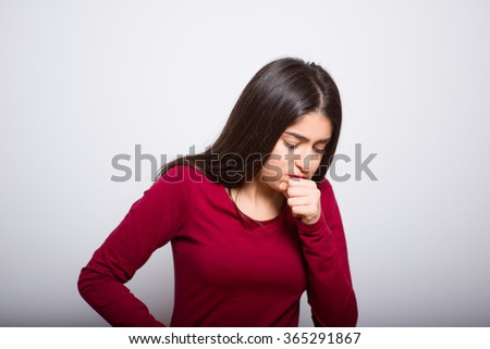 brunette business woman, sick and coughing, in a red dress, studio isolated portrait emotions - stock photo