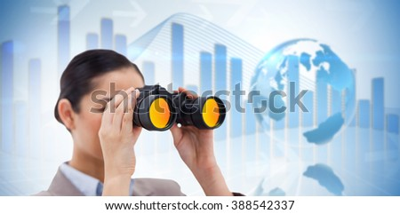 Brunette businesswoman looking through binoculars against global business graphic in blue - stock photo
