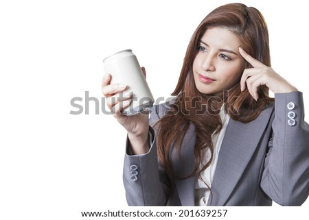 Brunette businesswoman with listening music on the desk sitting at office relaxation isolated on white back ground - stock photo