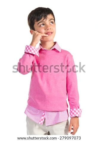 Brunette child making phone gesture  - stock photo