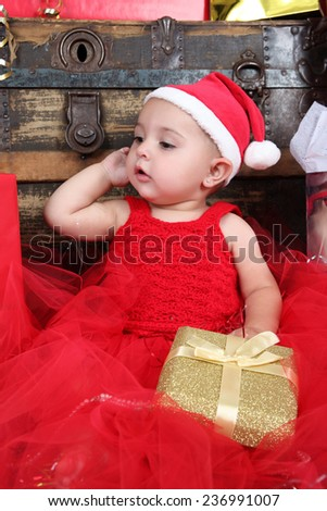 Brunette christmas baby girl wearing a long red tulle dress  - stock photo