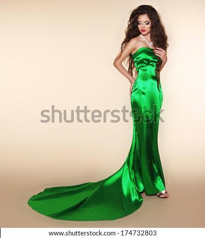 Brunette elegant woman in long dress with train. Fashion model posing. Super star - stock photo