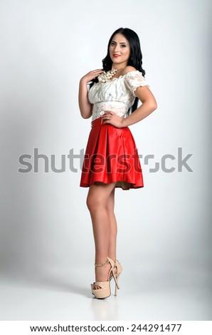 Brunette fashion model posing isolated on white background - stock photo