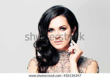 Brunette Fashion Model Woman. Curly Hairstyle, Beautiful Face, Makeup and Diamond Jewelry - stock photo