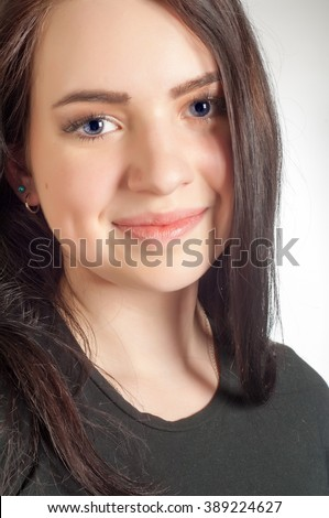 http://thumb101.shutterstock.com/display_pic_with_logo/3318821/389224627/stock-photo-brunette-girl-black-t-shirt-very-beautiful-girl-attractive-young-brunette-in-t-shirt-and-blue-389224627.jpg