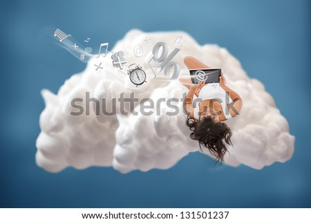 Brunette girl connected to cloud computing and using many applications - stock photo