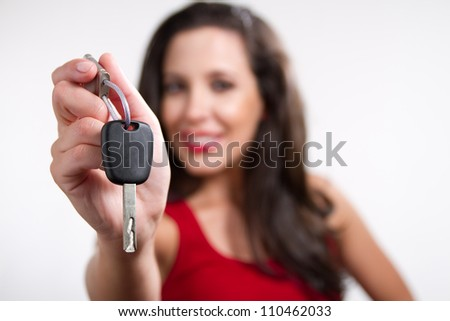 brunette girl holding a car key - stock photo