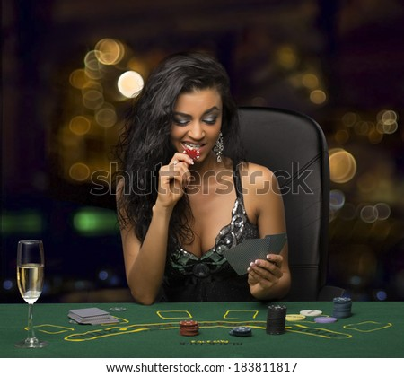 brunette girl in the casino playing poker - stock photo